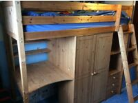 High sleeper, solid pine with wardrobe, 3 drawers, desk and shelves.