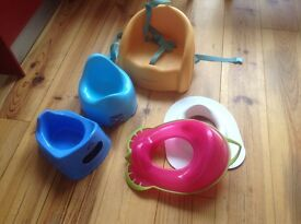 Plastic booster seat for table. Toddlers toilet seat and potties