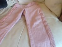 Girls age 8 pink jeans/trousers from Next