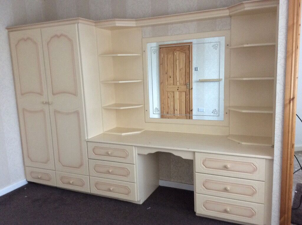 Fitted Wardrobe With Integrated Dressing Table Unit In