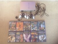 Ps2 Silver limited edition console with both leads and 2 joypads and 10 Games inc Crash Bandicoot