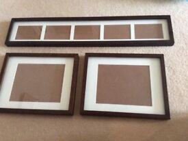 Dark wood picture frames in various sizes