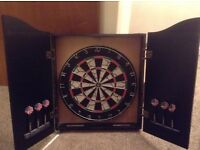 DARTBOARD, 2 SETS OF DARTS AND CABINET/ CUPBOARD (AS NEW)