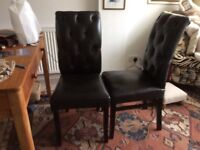 2 black button back dining chairs