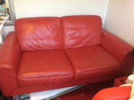 Stunning hide red leather sofa, good con bargain only £90 silly price viewing welcome