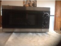 TESCO microwave, hardly used in clean excellent condition . Black and Silver