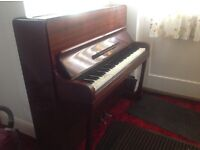 WH Barnes upright Piano - in fairly good condition for it's age, plays well just needs tuning