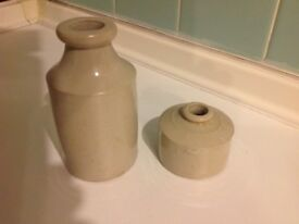 Two old fashioned looking stone pots suitable flower arrangements