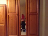 Pine wardrobe with a mirror in middle