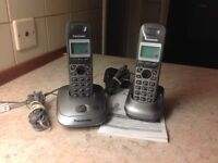 Twin Panasonic phones, with loud speaker facility.