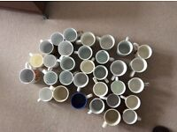 32 cups and mugs.