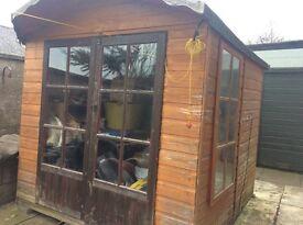 Wooden summerhouse, watertight, 2 front opening doors, buyer to dismantle and uplift.