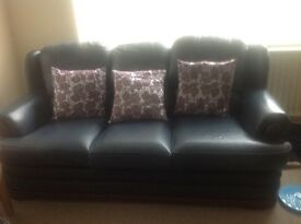 Leather sofa and poufe