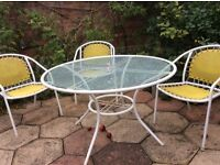 Patio table and four chairs. Glass top table in excellent condition.