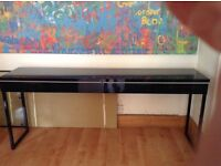 Black two drawer desk in excellent condition. Height 78cm Depth 41cm Width 180cm.