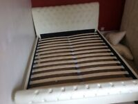 Double cream leather bed frame. Must collect