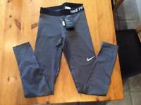 NEW with tags - Nike Pro Women's Running Tights (small - full length)