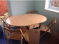 Butterfly folding dining table with four chairs