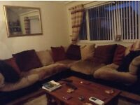 large leather corner suite , with velour cushions