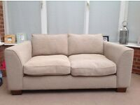 Small sofa in a natural weave material. Washable covers. W-176. D-95 H-67cms.