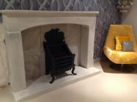 Large stone fireplace and cast iron grate