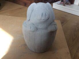 Concrete garden pig in barrel ornament