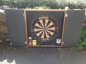 Winmau Dart Board and Cabinet with 2 sets of darts and other accessories
