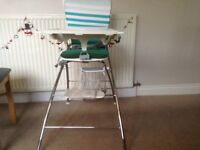 Folding tubular high chair hardly used
