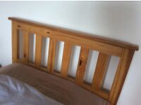 Single pine bed , with spare guest bed underneath