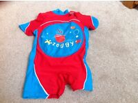 Zoggy zoggs swim suit with inflatable tummy for buoyancy. Aged 2-3. Weight 15-18 kgs