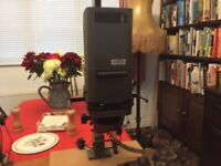 Two photographic enlargers to sell together as one lot.