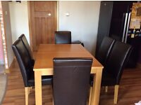 Beech extended dinning table and 6high back leather chairs excellent condition £199