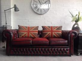 Oxblood 3 seater Chesterfield sofa. One of a pair.