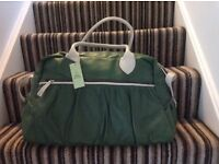 Leather overnight bag. Green leather with cream trim. Tags still on. Zipped pocket on front and back