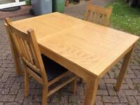 Solid oak extendable dining table n 2 chairs