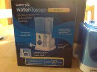 Waterflosser, Waterpik
