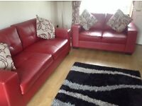 Red leather settees 2&3 seater for sale £350 ono