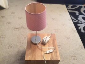 Pink shaded bedside table lamp