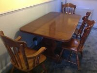 Dark Oak extendable dining room table and 8 chairs