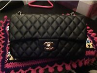 Chanel black handbag with gold chain
