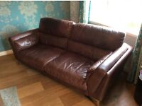 Brown leather DFS sofa and brown cuddler swivel.