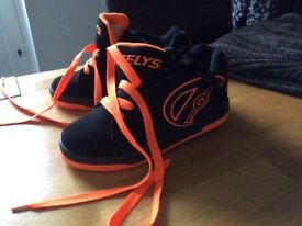 Girls heely trainers orange and black size 3