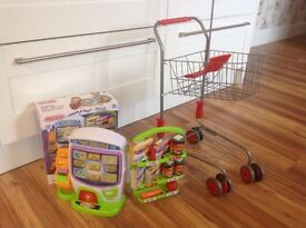 Cason self-service checkout and metal shopping trolley