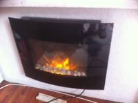 Wall fire as good as new, comes with remote and has backlight that changes colour