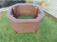 New stained wooden garden planters