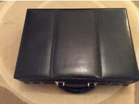 Briefcase with interior writing board