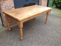 Large pine table 6ft X 3 ft (1800 X 900). Very solid.