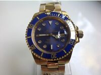 Rolex- submariner – all gold – blue dial – Diamond markers