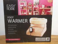 Foot Warmer. Brand new. Unopened in original packaging.