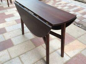 Classy folding / circular wooden table